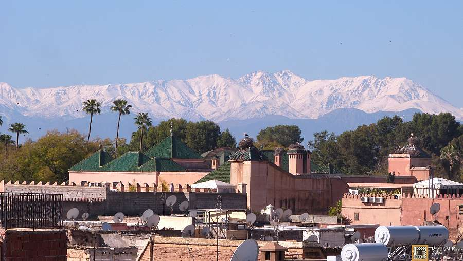 Marrakech_Riad_Al_Ksar_with_royal_palace_and_atlas_mountains_view_from_hotel_terrace